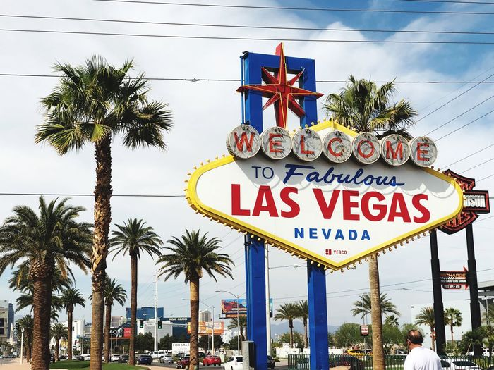 Las Vegas Welcome Sign Vegas Sign Vegas  Las Vegas Communication Text Western Script Sign Tree Plant Road Sign Sky Welcome Sign