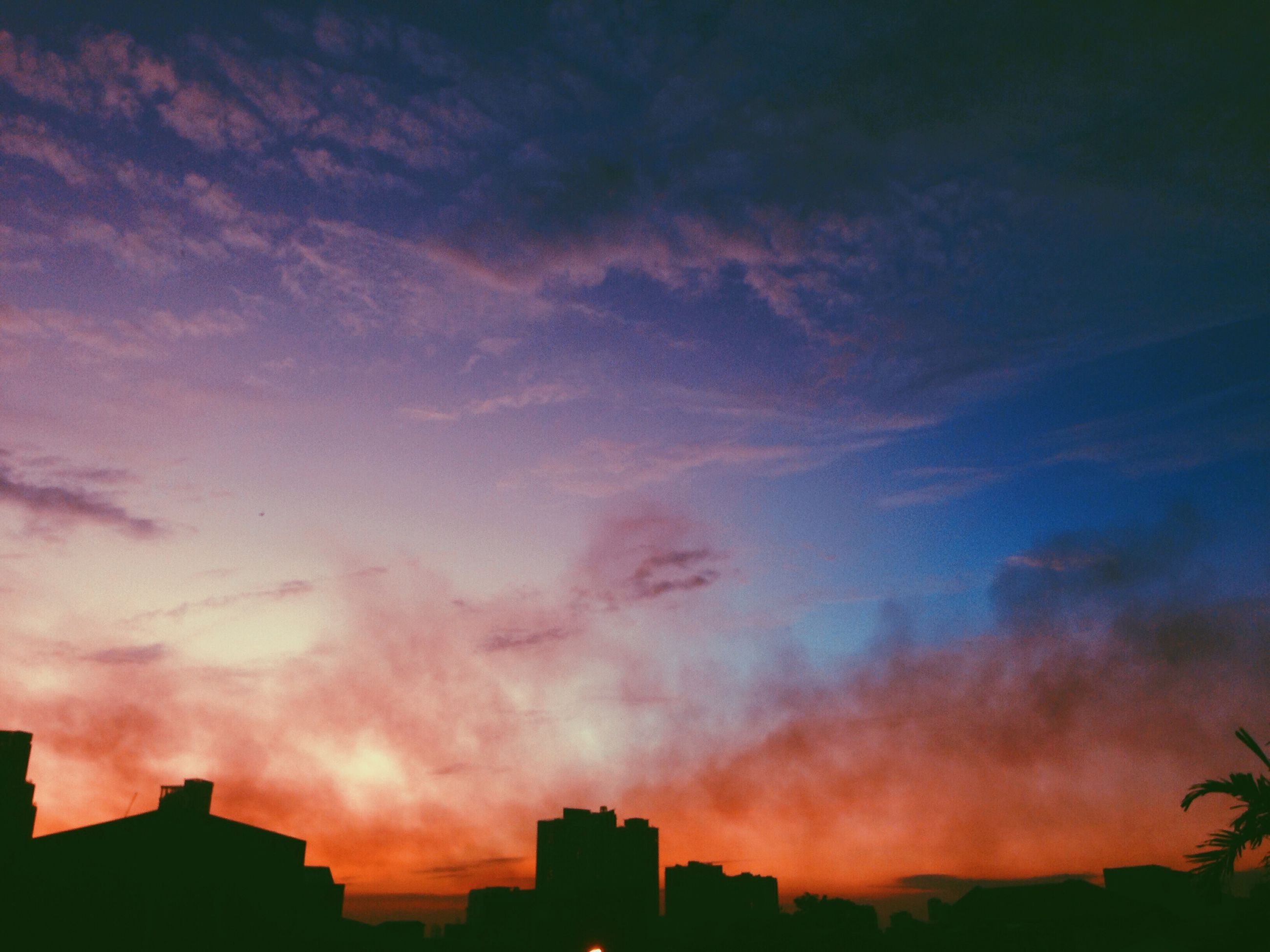 sunset, sky, building exterior, silhouette, architecture, built structure, cloud - sky, beauty in nature, low angle view, dramatic sky, scenics, cloudy, orange color, cloud, nature, house, weather, outdoors, tranquility, dusk