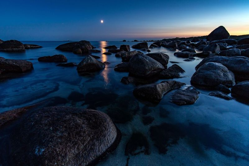 midnights in norway Norway Canon6dmarkii Emeyebestshot Clear Water Water By Night Night Viewpoint Reflection Midnight Sundown Ocean Sky Water Scenics - Nature Land Rock Beauty In Nature Sea Beach Tranquil Scene Solid Night Tranquility Rock - Object Nature No People Blue Moon Astronomy HUAWEI Photo Award: After Dark EyeEmNewHere