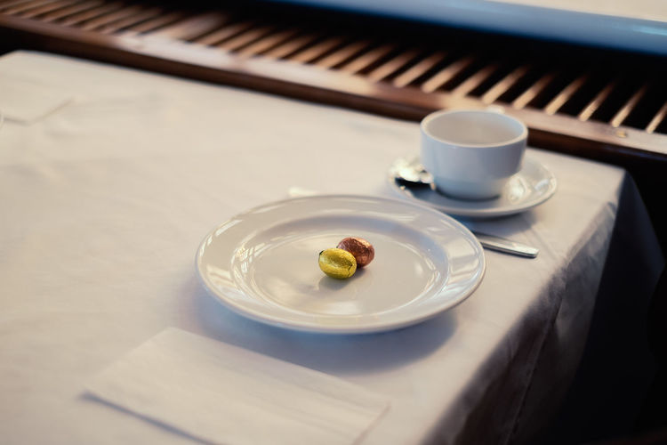 Springtime Decadence Easter Egg Easter Eggs Easter Table Indoors  Food And Drink Cup Plate Coffee Cup Mug Close-up No People Crockery Still Life Focus On Foreground Tray Drink High Angle View Coffee Coffee - Drink Musical Instrument Refreshment Food Music Selective Focus Piano Key