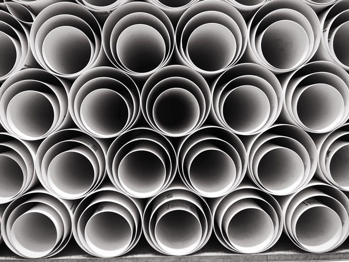 Full Frame Backgrounds No People Geometric Shape Circle Close-up Repetition Pattern Design Pipe - Tube Industry Large Group Of Objects Side By Side In A Row Shape Abundance Order