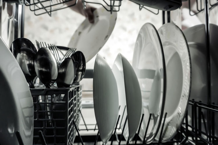 Close-up of kitchen utensils in rack