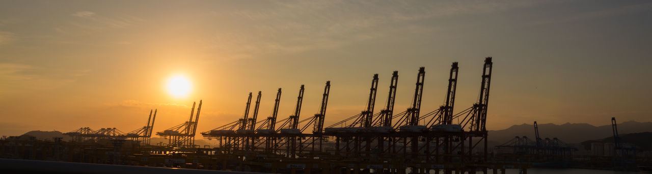 It's magnificent to see cranes lining the industrial port.