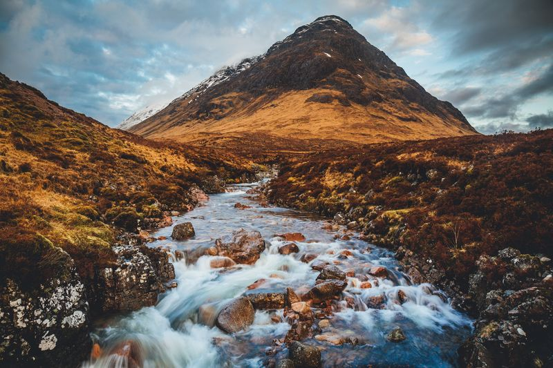 Glen Coe at daybreak Glencoe Glen Coe Scottish Highlands Highlands Of Scotland Highlands River Stream Sky Cloud - Sky Mountain Beauty In Nature Scenics - Nature Nature No People Tranquil Scene Tranquility Mountain Range Mountain Peak 2018 In One Photograph