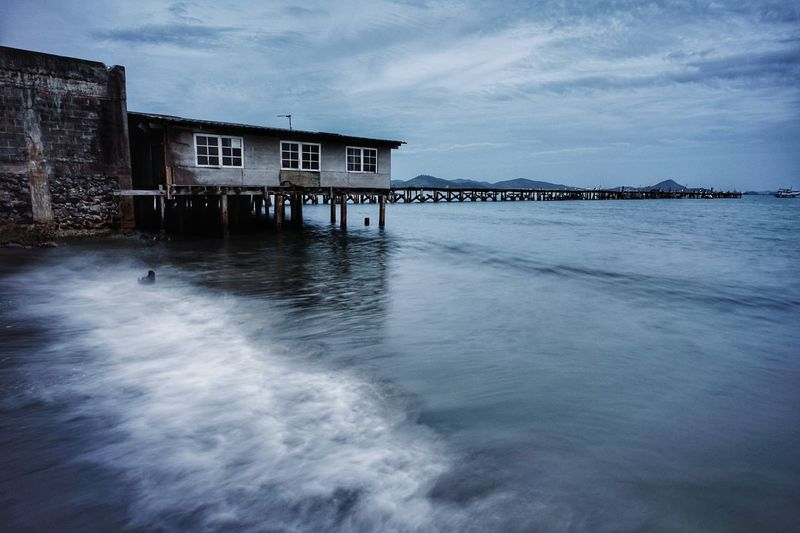 Water Sea Stilt House Sky Architecture Building Exterior Built Structure Cloud - Sky Wooden Post Countryside Seascape Moored Tranquil Scene Coast