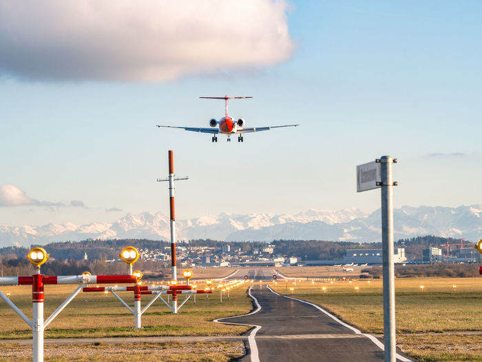 Low angle view of airplane landing at airport