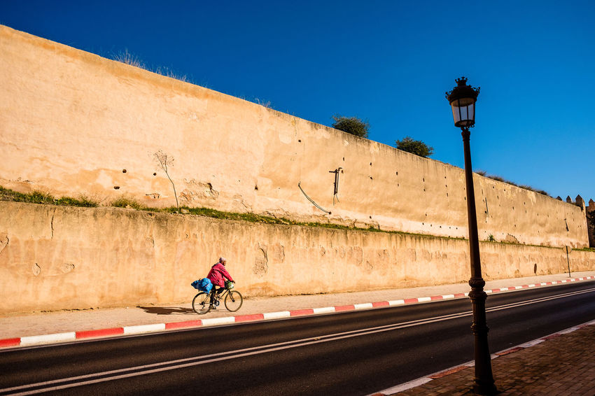 Art is Everywhere City EyeEmNewHere Life In Motion Lines Meknès Moroccan Architecture Moroccan Style Morocco Travel Art Bycicle Citywall Contrasting Colors One Man Only Outdoors Road Tourism Travel Destinations