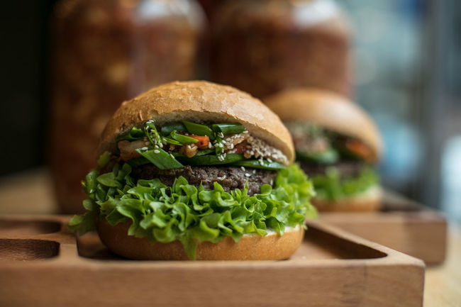 Bread Brown Paper Bun Canonphotography Close-up Day Dine Eat Fast Food Focus On Foreground Food Food And Drink Freshness Gourmet Hamburger Hospitality Indoors  Lettuce Light And Shadow No People Ready-to-eat Restaurant Sandwich The Week Of Eyeem