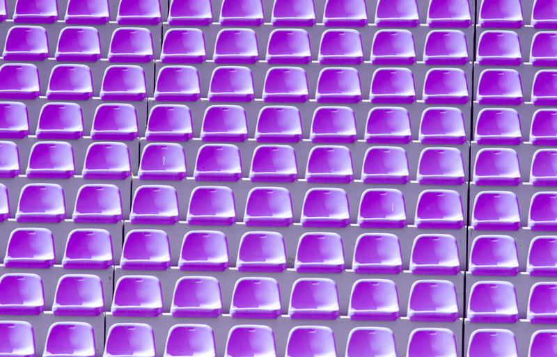 Empty violet plastic chairs in a row at the football stadium Empty Stadium Chair Background Competition Sport Game Play STAND Concert Fans Team Seat Plastic Blue Row LINE Pattern Arena Section Playground Field Theater Club Championship Cup Ground Light Rendering Lamp Electricity  Green Soccer Football Shiny Win Summer Power Floodlit Number Audience Tribune Grand Floodlight Colorful Visit Texture Abstract Spectator Purple Healthcare And Medicine No People Backgrounds Full Frame Repetition In A Row Studio Shot Close-up Selective Focus Pink Color Indoors  Computer Equipment Large Group Of Objects Education Medical Test Medicine Blood Keyboard Computer Key