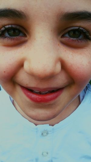 Beautiful Child Portrait Child Smiling Looking At Camera Human Face Childhood Headshot Human Eye Happiness Close-up