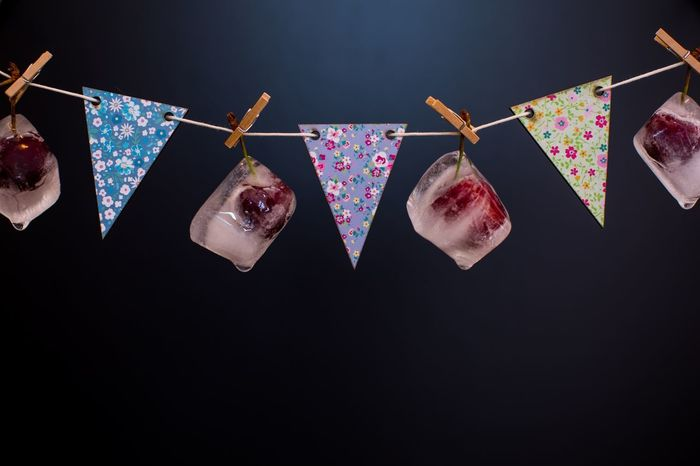 Cherries in ice cubes EyeEmNewHere Fruit Cherries Frozen Fruit Frozen Ice Cube Ice Clothespin Hanging Clothesline No People Indoors  Studio Shot Black Background Multi Colored Close-up EyeEmNewHere