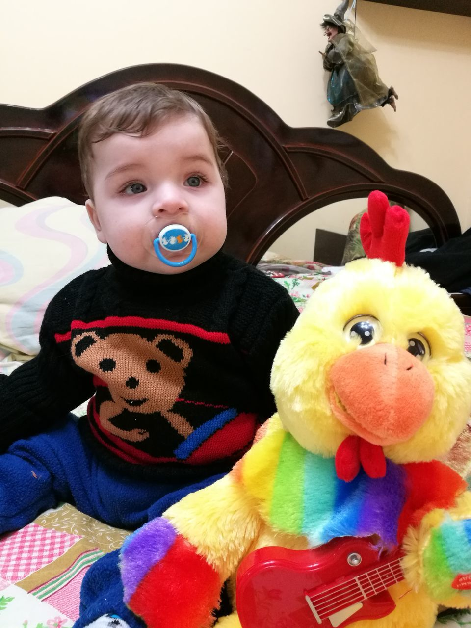 childhood, toy, stuffed toy, animal representation, innocence, teddy bear, looking at camera, cute, real people, boys, indoors, portrait, home interior, doll, close-up, lifestyles, one person, smiling, pacifier, day