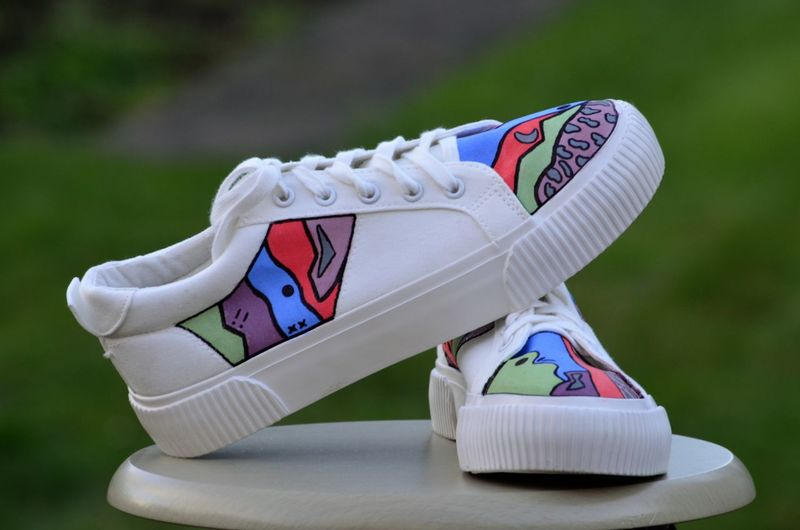 Close-up of white toy shoes