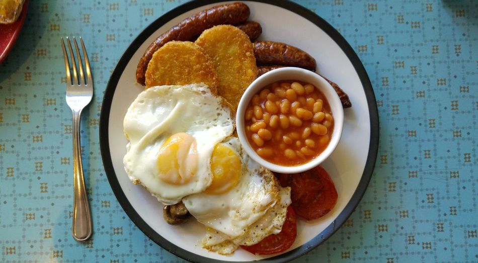 Plate of english breakfast on table