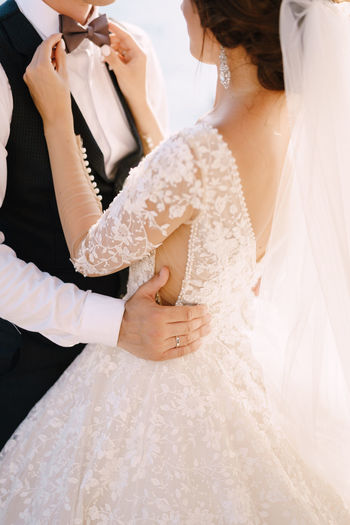 Midsection of couple at wedding