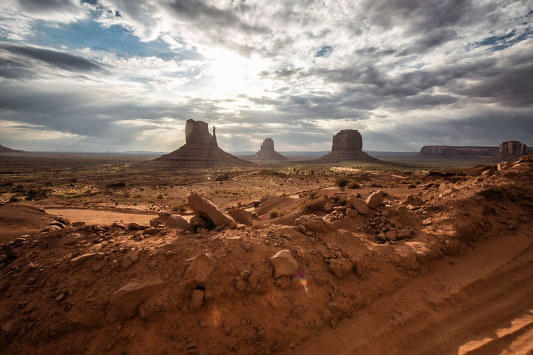43 Golden Moments Arid Climate Beauty In Nature Cloud Cloud - Sky Cloudy Desert Famous Place Geology Landscape Monument Valley Nature Non-urban Scene Outdoors Physical Geography Remote Rock - Object Rock Formation Scenics Sky Tourism Tranquil Scene Tranquility Travel Destinations The Great Outdoors - 2017 EyeEm Awards
