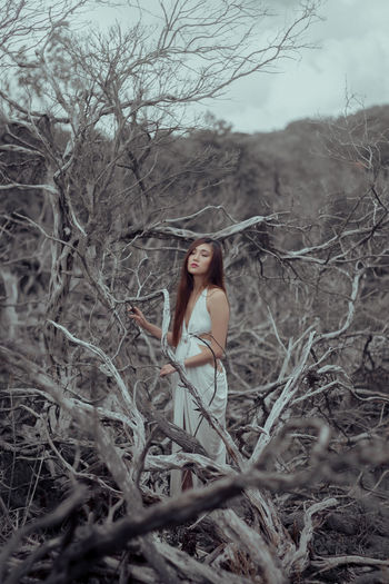 Adult Adults Only Bare Tree Beautiful People Beautiful Woman Beauty Branch Brown Hair Day Fashion Model Full Length Long Hair Looking At Camera Nature One Person One Woman Only Only Women Outdoors People Portrait Standing The Portraitist - 2017 EyeEm Awards Tree Women Young Adult