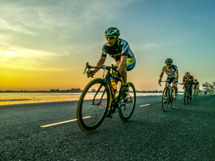 Sunset Sport Bicycle One Person Only Men One Man Only Leisure Activity Healthy Lifestyle Transportation Cycling Outdoors Skill  Adults Only People Men Young Adult Sky Sports Track Adult Headwear Clinging To Life Cyclingphoto Thailand Surin My Year My View