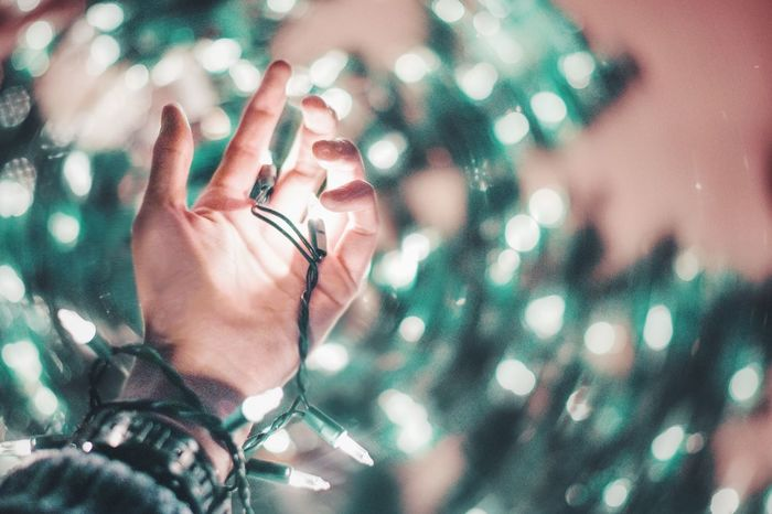 He who has no Christmas in his heart won't find it under a tree. Christmas Christmas Decoration Personal Perspective Christmas Ornament Christmas Tree Out Of Focus Depth Of Field 50mm Photography Green Hand Alone Christmas Lights Christmastime Fairy Lights