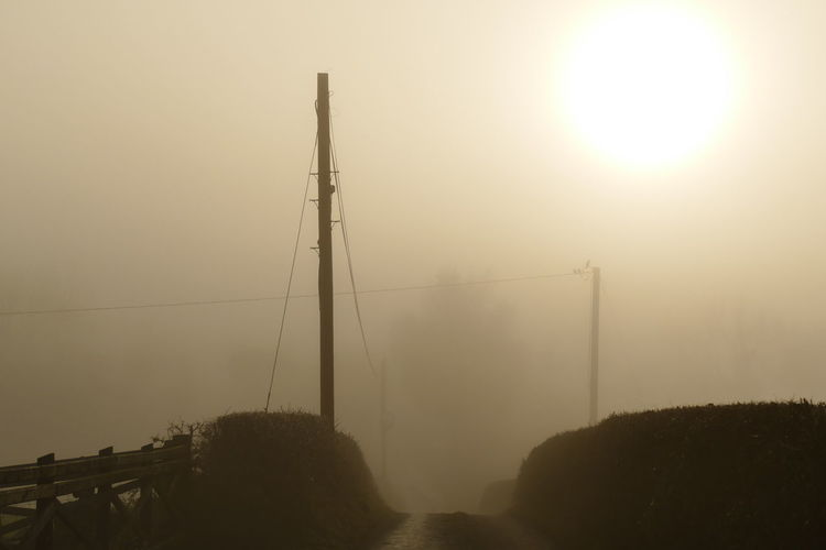 Foggy day.. Beauty In Nature Connection Day Dream States Electricity  Electricity Pylon Ethereal Fog Foggy Foggy Weather Nature No People Outdoors Renewable Energy Silhouette Silhouette_collection Sky Softness Sun Sunset Perspectives On Nature