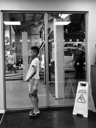 Full length of boy standing in store