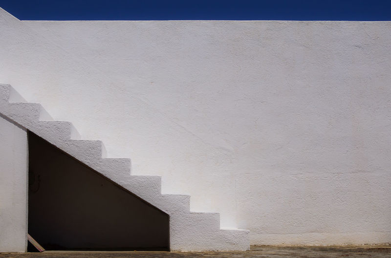 Steps on white wall