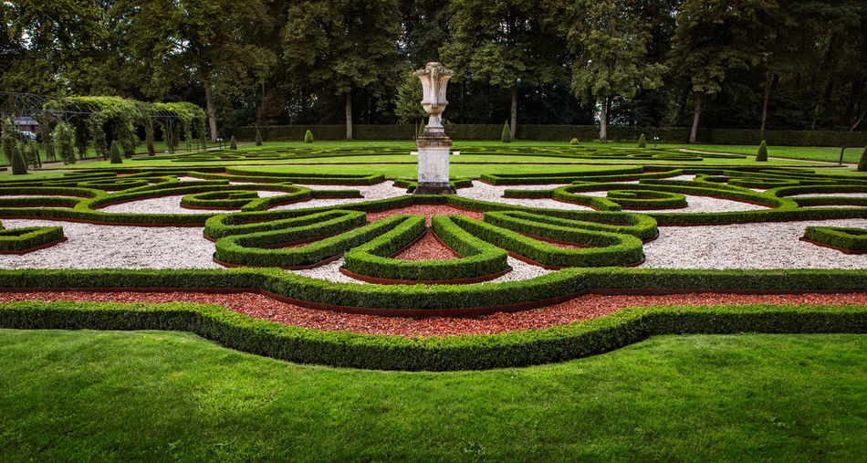 Beauty In Nature Day Flowerbed Formal Garden Garden Garden Path Grass Green Color Growth Hedge Landscaped Lawn Maze Nature No People Ornamental Garden Park Park - Man Made Space Plant Topiary Tranquility Tree
