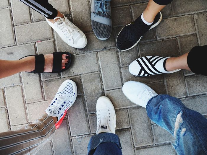 High engle group of people feet wearing shoes in circle. Vacation Travel EyeEm Selects Low Section Shoe Group Of People Human Leg Real People Human Body Part Standing High Angle View Body Part Personal Perspective Leisure Activity Friendship Women Human Foot Lifestyles People Adult
