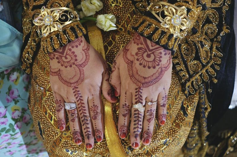 Traditional Indonesian Wedding Cultures Celebration Traditional Clothing Wedding Ceremony Tradition Wedding Human Hand Lifestyles Pattern Human Body Part Religion Women Bride Close-up Midsection Ceremony Two People Sari Adult People Hena Henatattoo Hands Paint Bodypaint