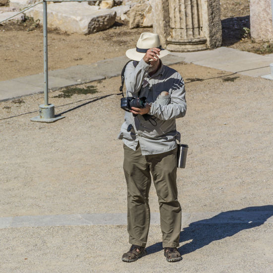 Tourist_20 Cap Casual Clothing Day Epidaurus Fotography Full Length Hat Jacket Leisure Activity Lifestyles Man Outdoors Portrait Shadow Summertime Sunlight Sunset Vacation Time
