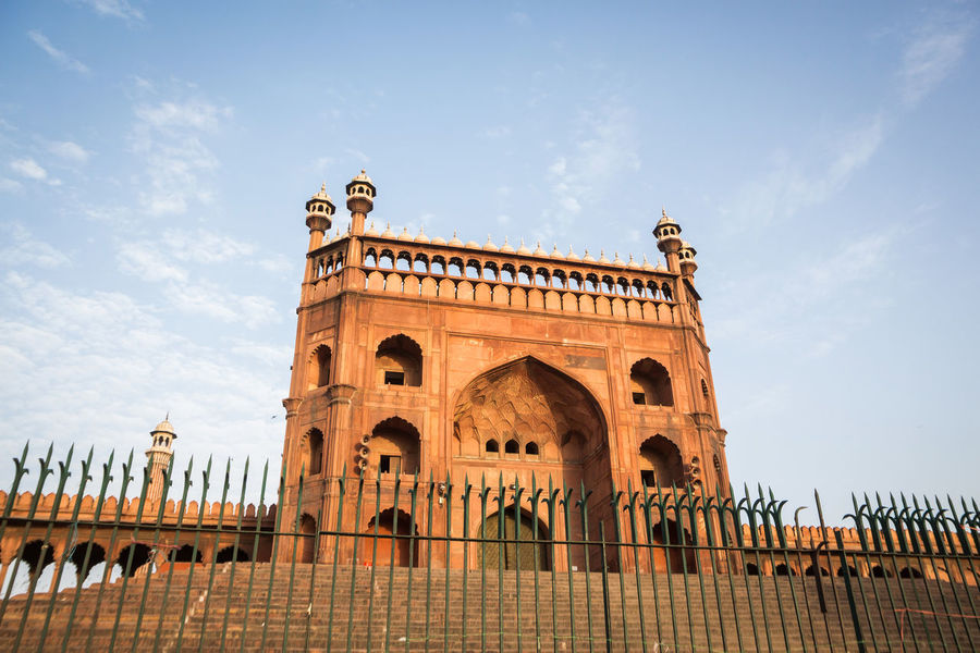 view of Jama Masjid from exterior in Delhi, India Arch Architecture Built Structure Delhi Exterior Fence Historic History India Indiapictures Indiatravel JamaMasjid Landmark Low Angle View No People Outside Tourism Travel Destinations