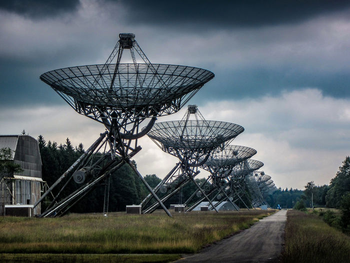 Cloud - Sky Day Global Communications Grass Landscape Nature No People Outdoors Radiotelescope Sky Technology Tree Westerbork