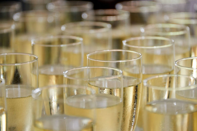 Close-up of champagne flutes arranged on table