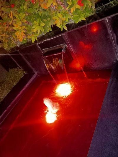 High angle view of illuminated fire hydrant at night
