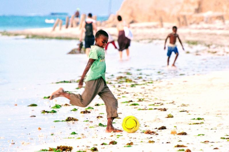 In his modest World, it's Championship every day. Africa Indian Ocean TheGreatOutdoors Travel World Cup 2018 Football Beach Full Length Land Child Sand Childhood Playing Real People Water Leisure Activity Lifestyles Sea Day Nature Outdoors The Traveler - 2018 EyeEm Awards The Great Outdoors - 2018 EyeEm Awards World Cup 2018 Summer Sports #urbanana: The Urban Playground