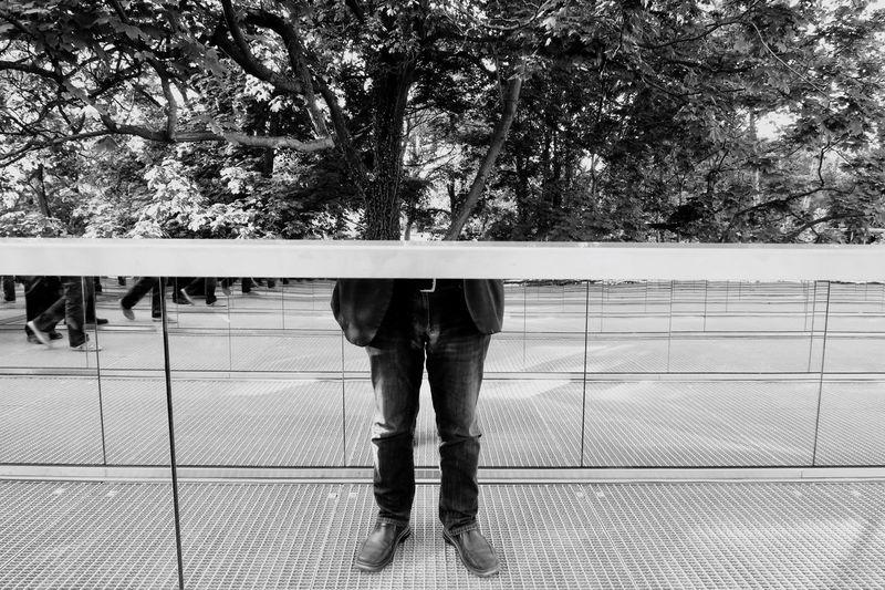 Man Standing Against Tree