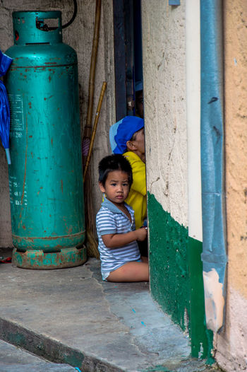 Afternoon Boy Building Exterior Children Cotidian Day Family Gas Gas Cylinder Grandmother Home House Kid Lifestyles Outdoors Sitting Street Photography Urban Vertical Village Village Life The Portraitist - 2017 EyeEm Awards