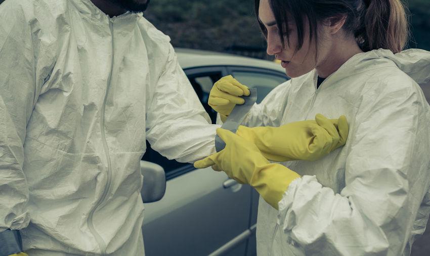 Woman applying bandage to man