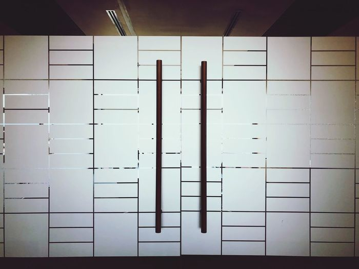 Background Indoors  Tile Flooring No People Wall - Building Feature Communication Close-up Day Text Built Structure Locker Room Architecture Dressing Room White Color Number Pattern Wall Mirror
