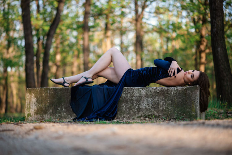 Woman relaxing on a tree
