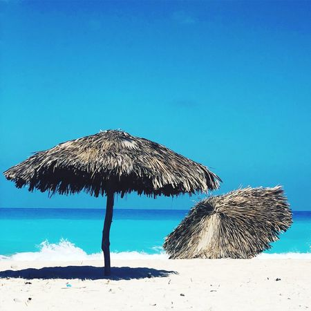 Blue Umbrella Sky Nature Water Parasol Sea Thatched Roof Day Clear Sky Beach Umbrella Shade Sunlight Land Beach Outdoors Tranquility Turquoise Colored