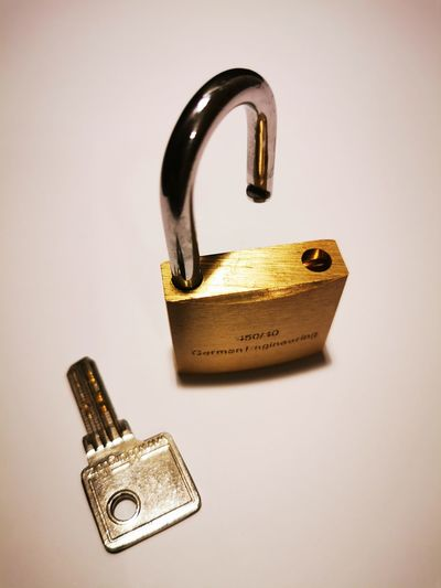 Close-up of love padlocks against white background
