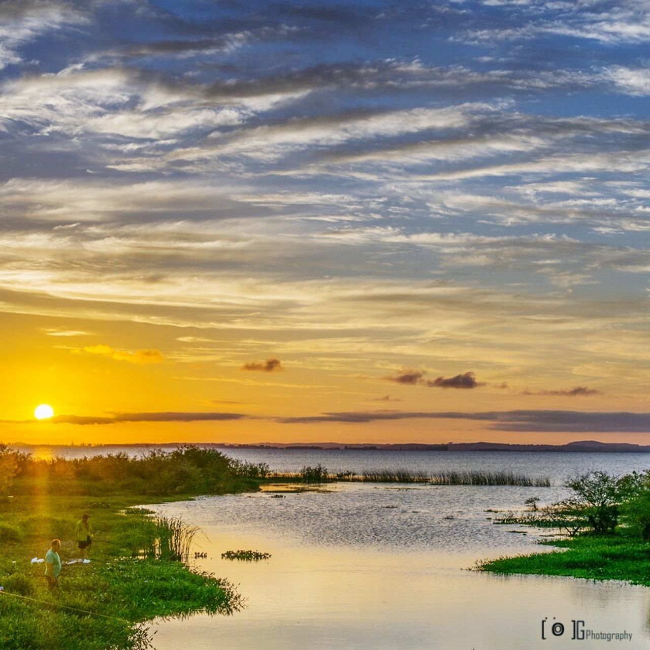 water, scenics, sunset, sky, tranquility, beauty in nature, nature, tranquil scene, cloud - sky, sea, beach, outdoors, landscape, no people, horizon over water, grass, tree, day