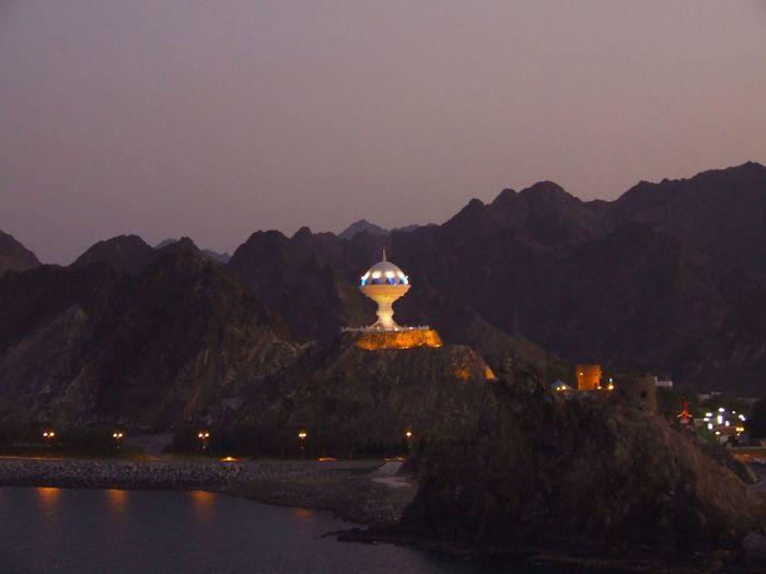 Illuminated Mountain Range Against Clear Sky At Night