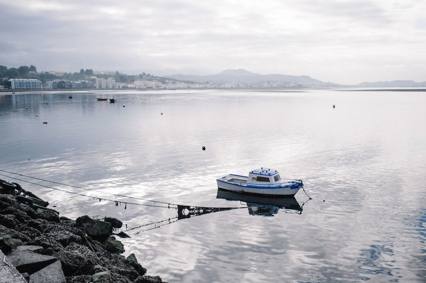 fisherboat (84% on the Roll. Grmph) Beauty In Nature Boat Calm Cloudy Hikinggalicia Idyllic Mode Of Transport Mountain Nautical Vessel No People Non-urban Scene Outdoors Scenics Sky Tourism Tranquil Scene Tranquility Travel Destinations Water What's On The Roll