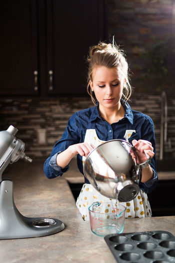 Baking Blond Hair Day Food And Drink Freshness Front View Indoors  Kitchen Kitchen Aid Muffin One Person People Real People Sweet Food Young Adult Young Women