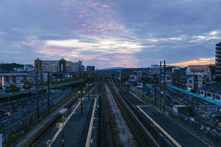 Cloud - Sky Sky Transportation Built Structure Architecture Building Exterior City Rail Transportation Railroad Track High Angle View Track Mode Of Transportation Nature Sunset No People Public Transportation Outdoors Direction Building The Way Forward Cityscape Long Capture Tomorrow