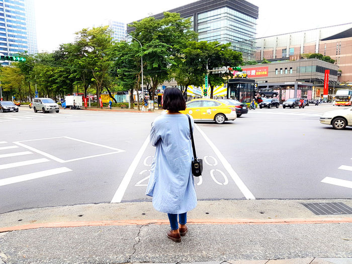 Rear view of girl on city street