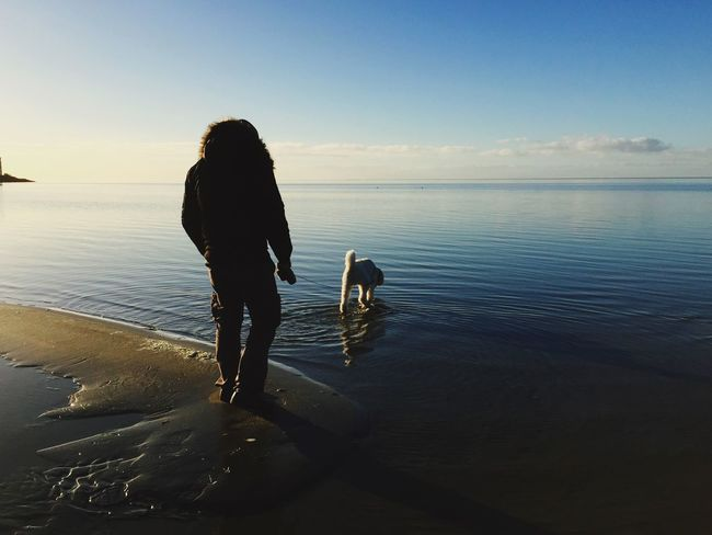 Beach Sea Water Rear View Real People One Person Reflection Full Length Outdoors Sky Sand Nature Standing Leisure Activity Horizon Over Water Vacations Scenics Beauty In Nature People Day