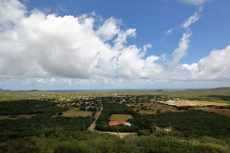 View over Bonaire Architecture Beauty In Nature Cloud - Sky Day Horizon Over Water Landscape Nature No People Outdoors Scenics Sky Tranquility Tree